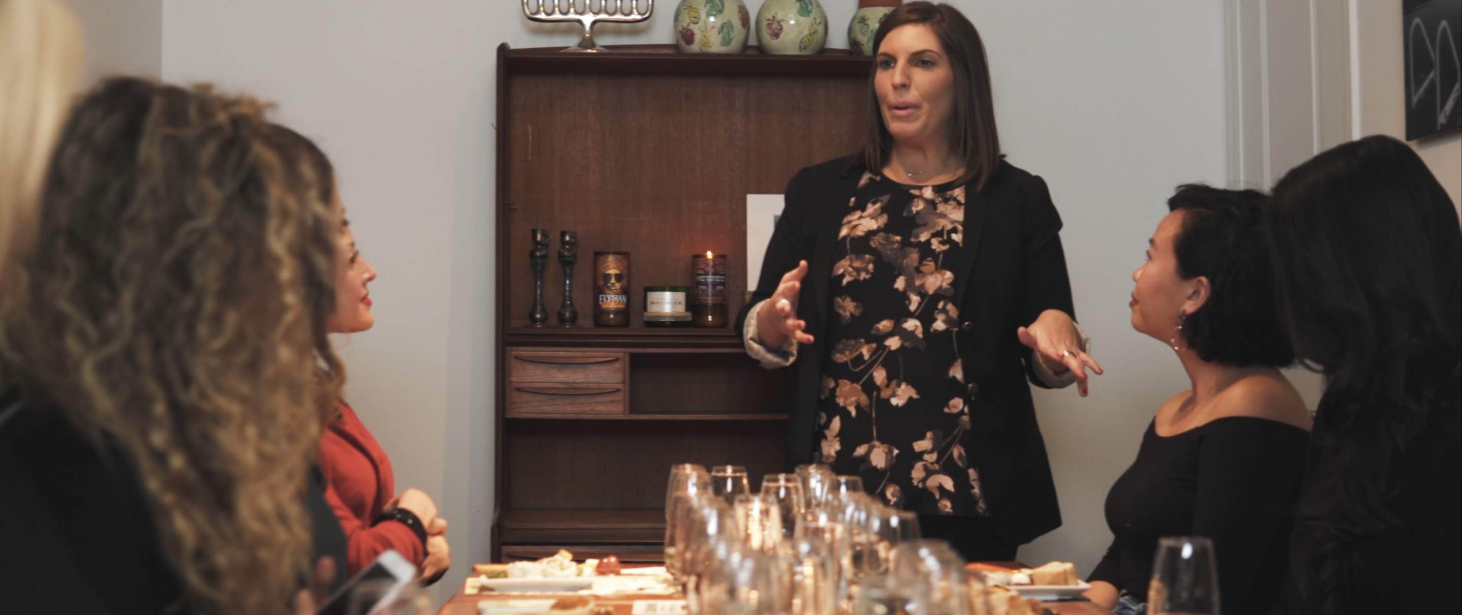 wine expert imparting knowledge to group