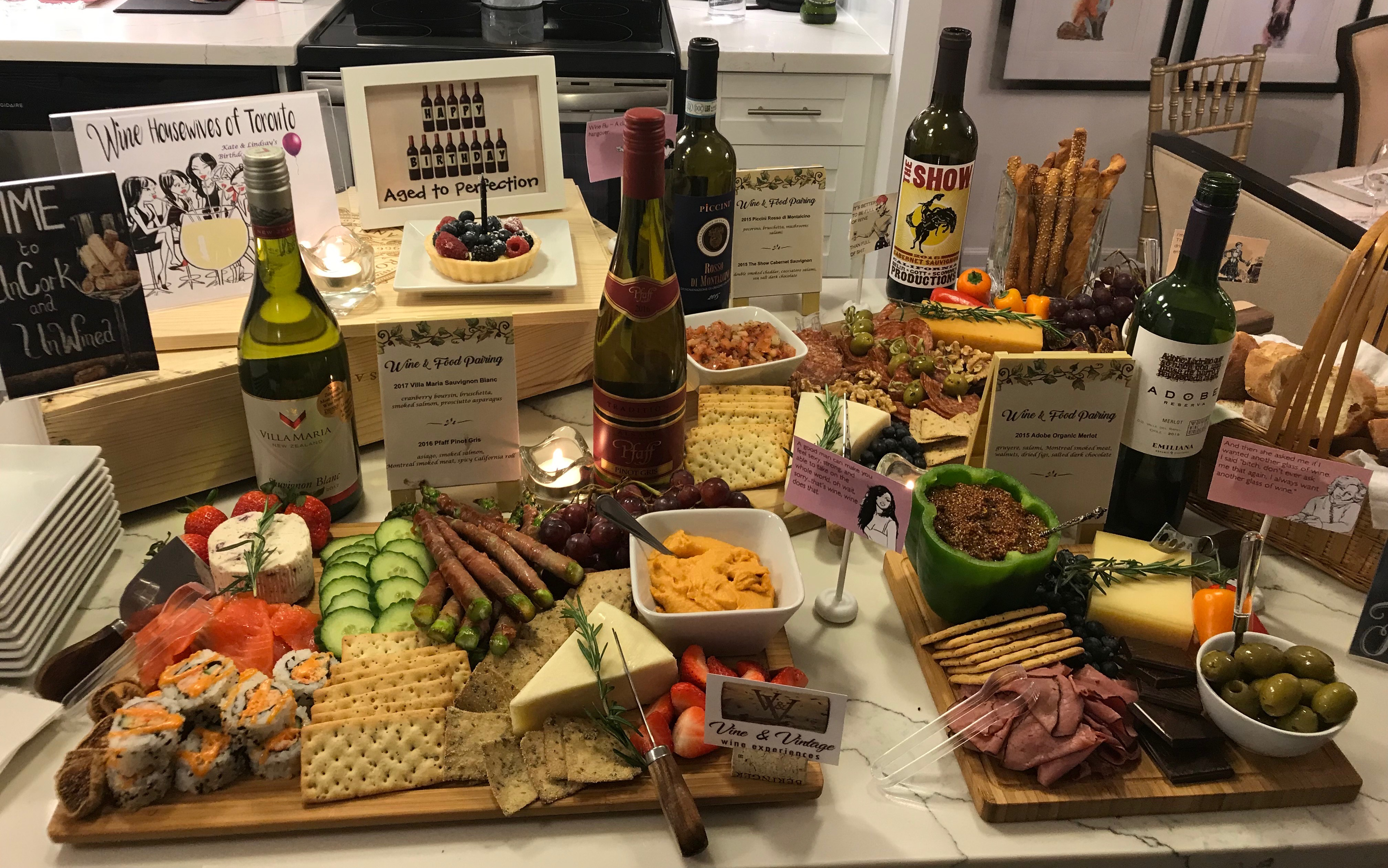 charcuterie spread of gourmet cheese, meat, sushi, seafood, veggies, chocolate, and more